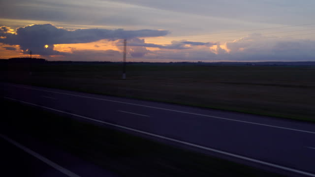 evening track on sunset background. shooting from the car moving the car forward. filming of the cargo atomobilya. in addition I drive cars and trucks. FullHD video