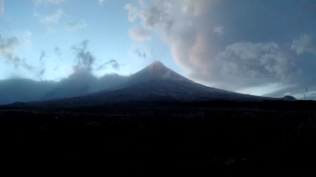 Evening view on erupting Klyuchevskoy Volcano - active volcano of Kamchatka (time lapse) video