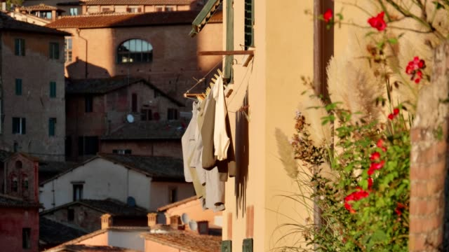 Evening view on the pretty streets and architecture of Siena, the famous medieval town in Tuscany, Italy.