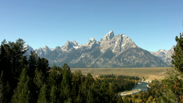 Evergreens line the Snake River Valley video