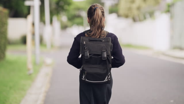 Every child yearns to learn 4k video footage of an unrecognizable young school girl walking to school outdoors one girl only stock videos & royalty-free footage