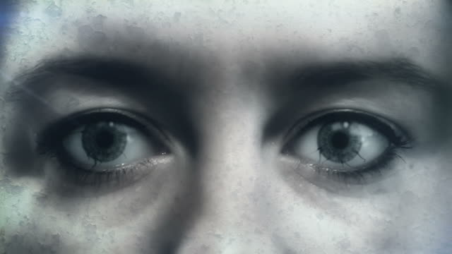 Evil in the Eyes - Zombie Infection Full HD composite of a female person with darkness spreading in her eyes. Useful as a visualization of zombie infection, demons, monsters or anything related to Halloween. ghost stock videos & royalty-free footage