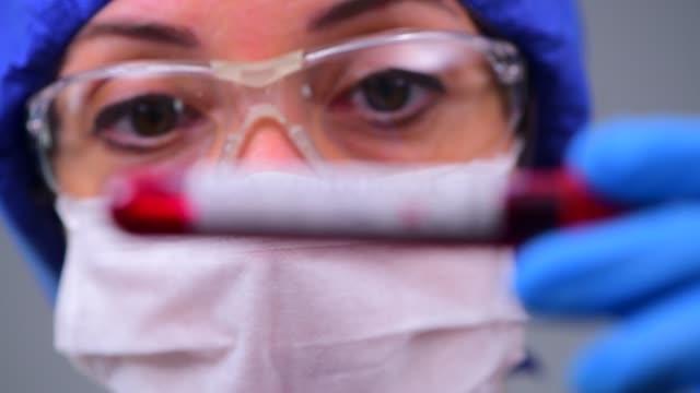 vídeos de stock e filmes b-roll de examining coronavirus covid 19 medical samples on kits novel corona virus outbreak - blood donation