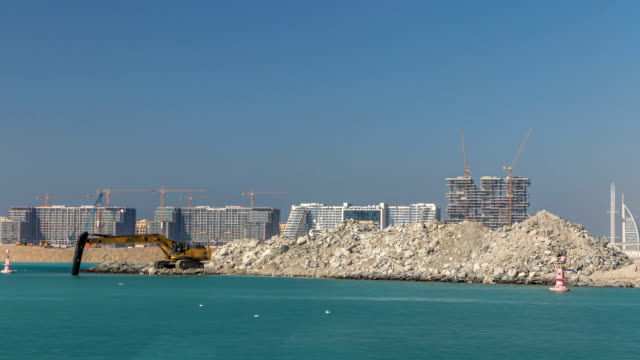 Excavator building a new part on the Palm Jumeirah timelapse