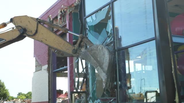 Excavator Demolishing Building Glass Wall video