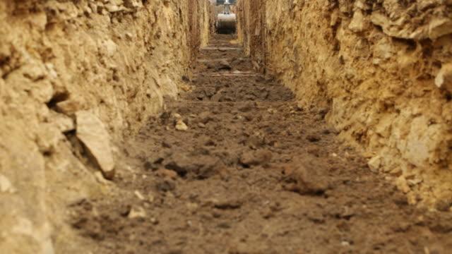 Excavator Graben Sie ein Geothermalfeld Trenchcoat – Video