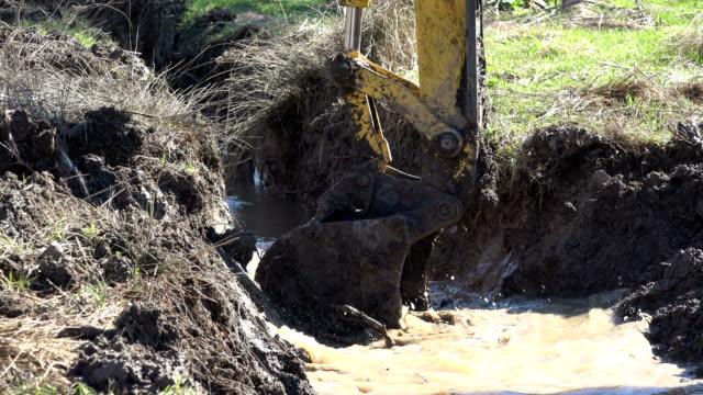 VARNA, BULGARIA - MAR 15, 2017 - Excavator dredging mud video