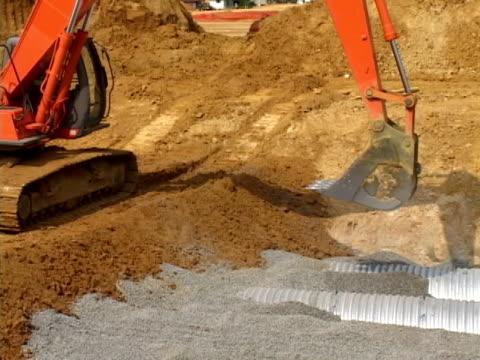 Excavator Dumps Gravel