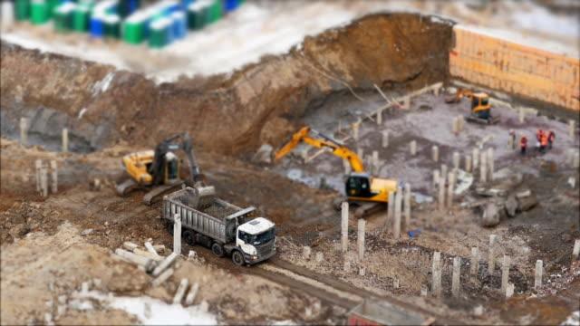 excavator loading  soil in truck - archeologia video stock e b–roll