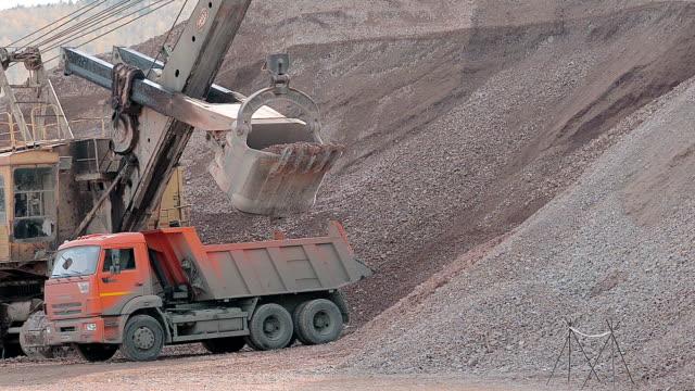 Excavator Loads Gravel Into a Truck