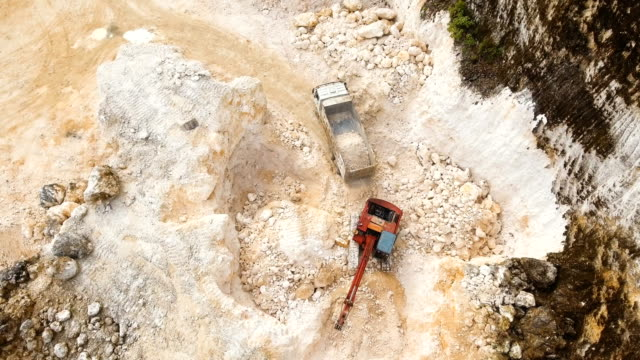 Excavator loads truck in quarry. Philippines,Siargao video