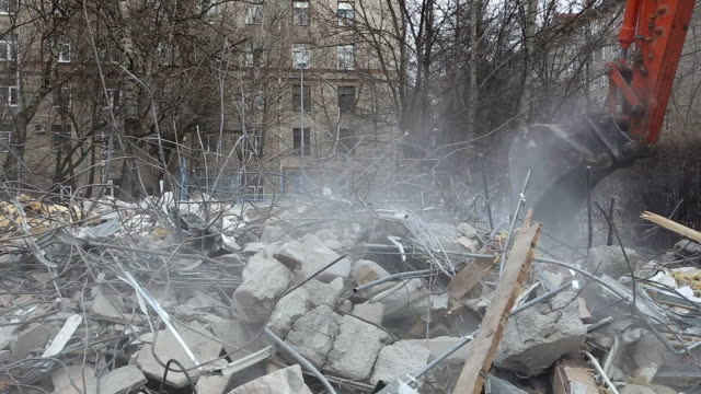 Excavator machinery working on demolition old house. Moscow, Russia video