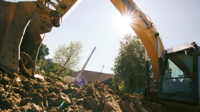SLO MO Excavator operating at a sunny construction site