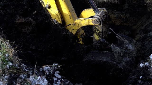 Excavator shovel digs into a ground Excavator shovel digs into a ground. HD construction equipment stock videos & royalty-free footage