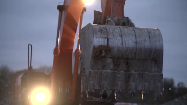 Excavator Transports the Ground at Night video