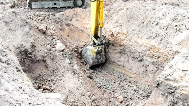 Excavator working at construction site video