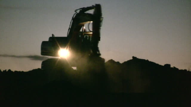 Excavator working at night video