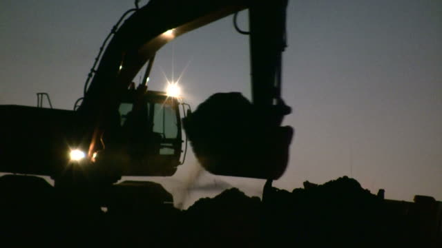 Excavator working at night Excavator working at construction site construction machinery stock videos & royalty-free footage