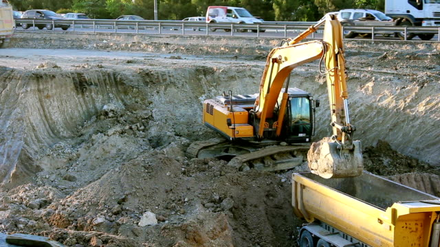 Excavator working on road video