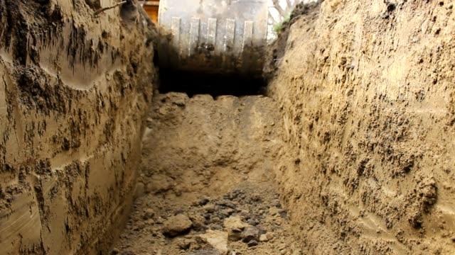 grävmaskin fungerar gatuarbete - excavator bildbanksvideor och videomaterial från bakom kulisserna