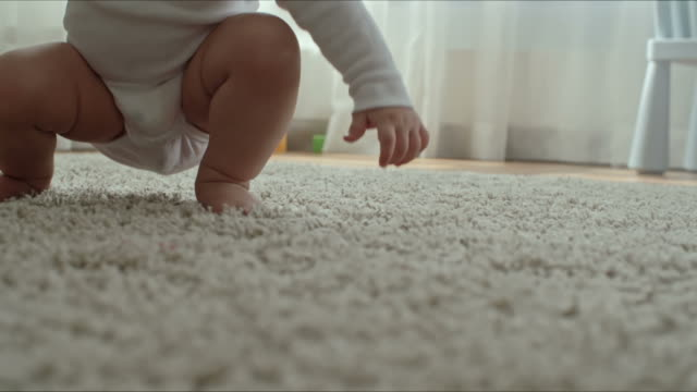 Excellent Crawler Closeup of barefoot baby crawling on soft shag rug on the floor in the living room crawling stock videos & royalty-free footage