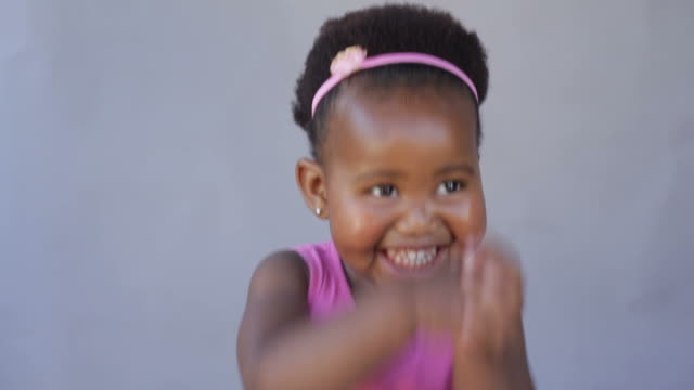 Excited african baby girl dancing with joy video