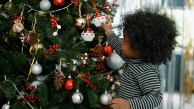 Excited African Cute Little Girl Celebrate Christmas at Home