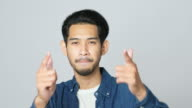 istock Excited asian man celebrating success while standing over light grey background, Happy asia male wining, reaching achievement, Headshot positive gesture and facial expression, 4k resolution 1268016442