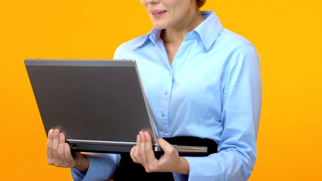 Excited business lady holding laptop and saying wow, shares climbed, market