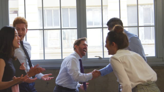 Excited business team celebrating success at a meeting, close up Excited business team celebrating success at a meeting, close up ecstatic stock videos & royalty-free footage