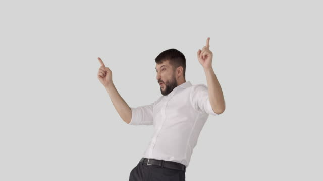 Excited businessman celebrating success Crazy businessman giving thumbs up and dancing while celebrating success over white background arms akimbo stock videos & royalty-free footage
