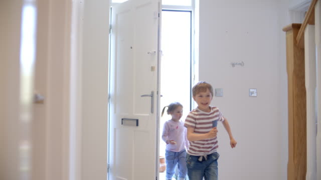 Excited Children Returning Home With Mother