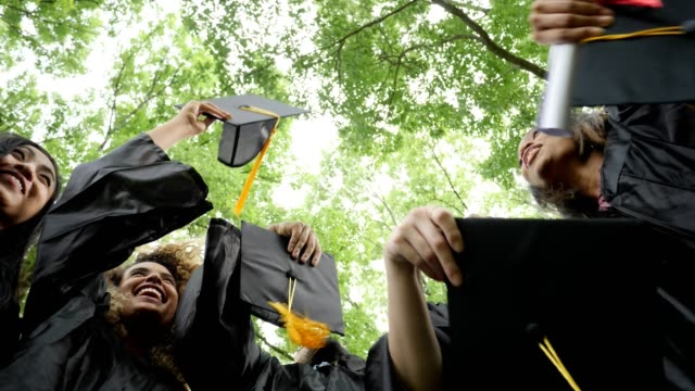 excited college graduates - cappello video stock e b–roll