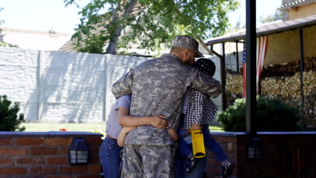 Excited family meeting serviceman at home Cheerful woman with children welcoming father and husband from military service looking super excited homecoming stock videos & royalty-free footage