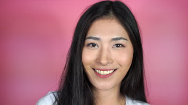 excited happy Asian woman  smiling closeup portrait of beautiful young woman