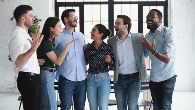 Excited happy multiethnic business team people celebrate corporate success