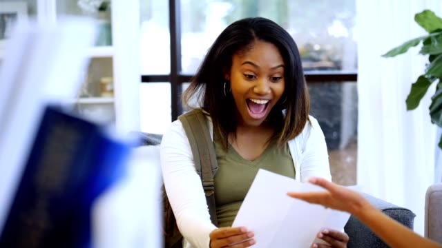 Excited high school senior opens college acceptance letter High school guidance counselor hands a female high school senior a letter. The teenage shouts with excitement as she realizes it is a college acceptance letter. She then thanks the counselor and breathes a sigh of relief. school counselor stock videos & royalty-free footage