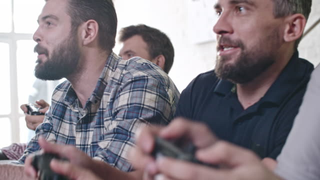 excited men playing video games at party - bachelor party stock videos and b-roll footage