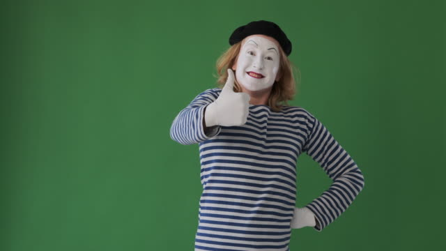 Excited mime artist giving thumbs up gesture Excited mime artist man giving thumbs up gesture over green background arms akimbo stock videos & royalty-free footage