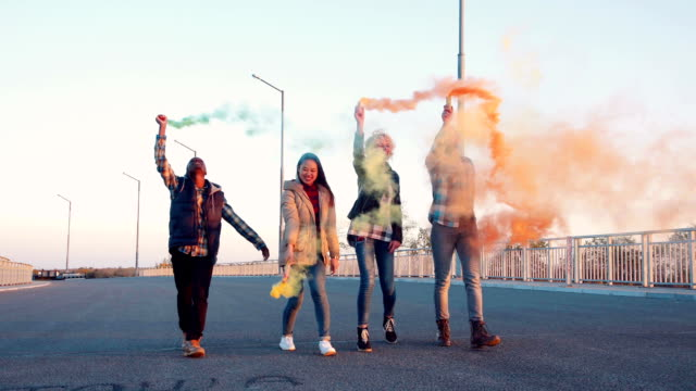 Excited people with colored smoke grenades video