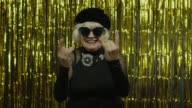 istock Excited positive senior woman showing rock and roll gesture and sincerely smiling, showing tongue 1272261324
