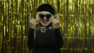 istock Excited positive senior woman showing rock and roll gesture and sincerely smiling, showing tongue 1272261469