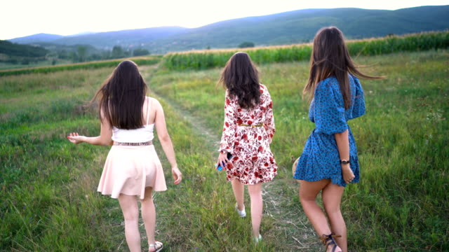 Excited pretty women enjoying freedom in nature