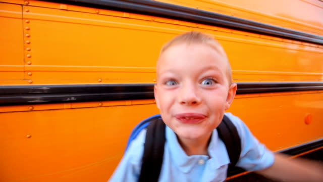 Excited school boy making faces video