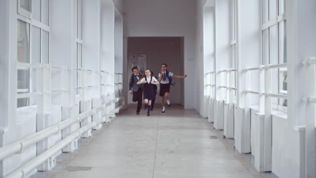 Excited Schoolchildren Running in Hallway video