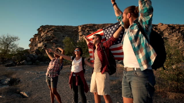 Excited travelers posing with flag video