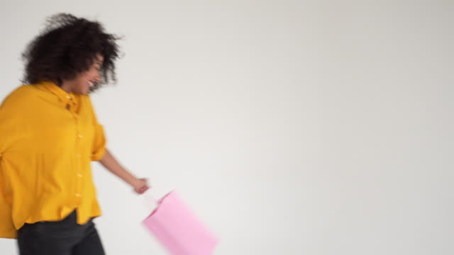 Excited woman carrying shopping bags video