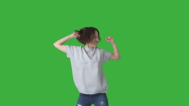 excited woman celebrating success over green background - sorpresa video stock e b–roll