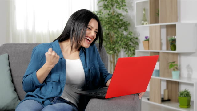 Excited woman finding amazing content on laptop