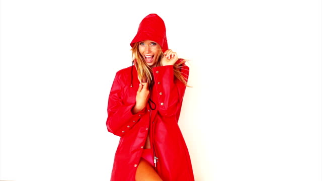 Excited woman in red coat